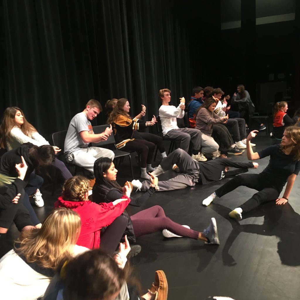 hypnotist and students in High School show